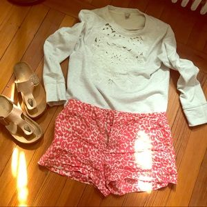 Coral & cream animal print shorts